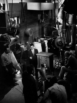 "oldhollywood:  The Twilight Zone's crew looks on as Rod Serling performs his on-camera narration for the episode Static (1961) (via) ""As I grow older, the urge to write gets less and less. I've pretty much spewed out everything I have to say, none of which has been particularly monumental. I've written articulate stuff, reasonably bright stuff over the years, but nothing that will stand the test of time. The good writing, like wine, has to age well with the years, and my stuff is momentarily adequate."" -Serling, 1972 (via)"