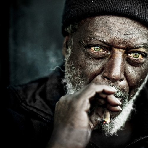 "Lee Jeffries,* writing as LJ. on flickr:  Untitled He did the strangest thing. Rolled up a joint in cardboard. Never seen that before but I guess if you got no paper you gotta make do. I've had a sheltered life.  Yet another mis-attributed work by an amazing artist that showed up on tumblr stripped of any connection to or mention of that artist.** Like most such images I come across, finding the true source of this photograph took me less than five minutes. It's possible that one or more of the thousands of tumblr users who reblogged this image before me also found the correct attribution information and included it with their post. But, unless the original post contains (or is edited to include) that information, and a link to that post is preserved through all reblog branches, the majority of the reblogs aren't going to include or even link to the correct source — that is, the artist who created the work being reblogged all over tumblrspace. It really isn't difficult or time-consuming to find sources for un- or mis-attributed works you come across on tumblr. If the work is (or includes as part of an image) text, you can put a quotation from it into your search engine of choice in order to locate the original source. With images, whether photographic or otherwise, Google Image Search has gotten really good at finding matching images even when they're cropped differently or otherwise (un)altered; just go to google.com/imghp, click the camera icon in the search box, and paste in the URL of the copy of the image you found on tumblr. With most images, the source will be either one of the first web results, or on the results page accessed by clicking either the ""All sizes"" link (near the top of the page, above webpage results) or a matching image in the ""Visually similar images"" link (near the bottom of the page, below webpage results). Even if you only look for the creator credit for things you want to reblog once in a while, every time someone takes those few minutes makes a difference…  * The photograph featured in this post is only one of literally hundreds of arresting portraits of homeless people that Jeffries has captured. His flickr photostream and website are both well worth the visit — though perhaps more wisely in moderation than marathon session, as the pain and adversity of life on the streets is more often highlighted than hidden in Jeffries's work, and those harsh realities are disquieting. Further comments from the photographer, as found on the flickr page:  The challenge of course is to try and make ""colour"" artistic. So much easier with a black and white shot. It helps having the right ingredients to start with. I saw his eyes from across the street and almost RAN to get to them!!!   I told him that he had stunning eyes too. He was a quiet man and just smiled and said thank you.   ** This reblog ultimately — according to the information on the tumblr-reblog where I found it, at least — traces back to a post made by realsh1t; the source & image links previously went to realsh1t's main page, however, rather than the post that began this thread, and, with five-thousand-plus notes, I'm not checking whether that attribution is accurate."