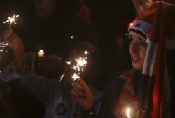 وأطفال عسل في ميدان التحرير في ليلة رأس السنة Egyptian kids hold sparklers at #Tahrir Square, the focal point of the Egyptian uprising, in Cairo December 31, 2011