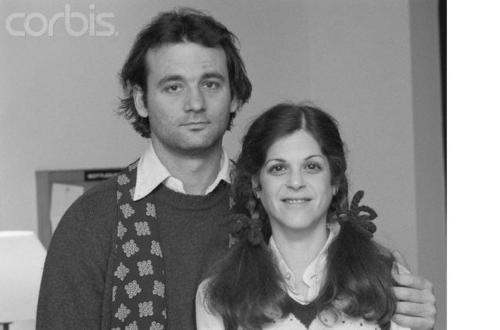 "huffpostcomedy:   Bill Murray on Gilda Radner: ""Gilda got married and went away. None of us saw her anymore. There was one good thing: Laraine had a party one night, a great party at her house. And I ended up being the disk jockey. She just had forty-fives, and not that many, so you really had to work the music end of it. There was a collection of like the funniest people in the world at this party. Somehow Sam Kinison sticks in my brain. The whole Monty Python group was there, most of us from the show, a lot of other funny people, and Gilda. Gilda showed up and she'd already had cancer and gone into remission and then had it again, I guess. Anyway she was slim. We hadn't seen her in a long time. And she started doing, ""I've got to go,"" and she was just going to leave, and I was like, ""Going to leave?"" It felt like she was going to really leave forever. So we started carrying her around, in a way that we could only do with her. We carried her up and down the stairs, around the house, repeatedly, for a long time, until I was exhausted. Then Danny did it for a while. Then I did it again. We just kept carrying her; we did it in teams. We kept carrying her around, but like upside down, every which way—over your shoulder and under your arm, carrying her like luggage. And that went on for more than an hour—maybe an hour and a half—just carrying her around and saying, ""She's leaving! This could be it! Now come on, this could be the last time we see her. Gilda's leaving, and remember that she was very sick—hello?"" We worked all aspects of it, but it started with just, ""She's leaving, I don't know if you've said good-bye to her."" And we said good-bye to the same people ten, twenty times, you know.  And because these people were really funny, every person we'd drag her up to would just do like five minutes on her, with Gilda upside down in this sort of tortured position, which she absolutely loved. She was laughing so hard we could have lost her right then and there. It was just one of the best parties I've ever been to in my life. I'll always remember it. It was the last time I saw her."" - from Live from New York: an Uncensored History of Saturday Night Live  [via oldloves]"