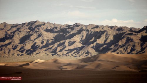 Gobi desert with mountains behind.