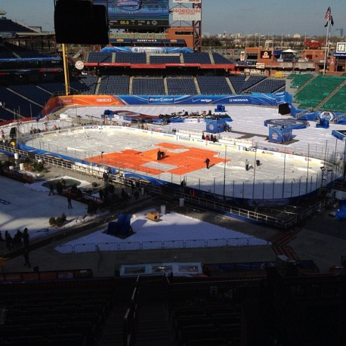 Fake snow being spread. Tarp over the ice.  (Taken with Instagram at 2012 Bridgestone NHL Winter Classic)