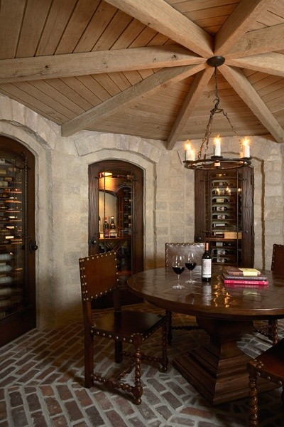 Fabulous wine cellar with stone walls, a brick floor, and an octagonal wooden ceiling (via  Martha O'Hara Interiors)