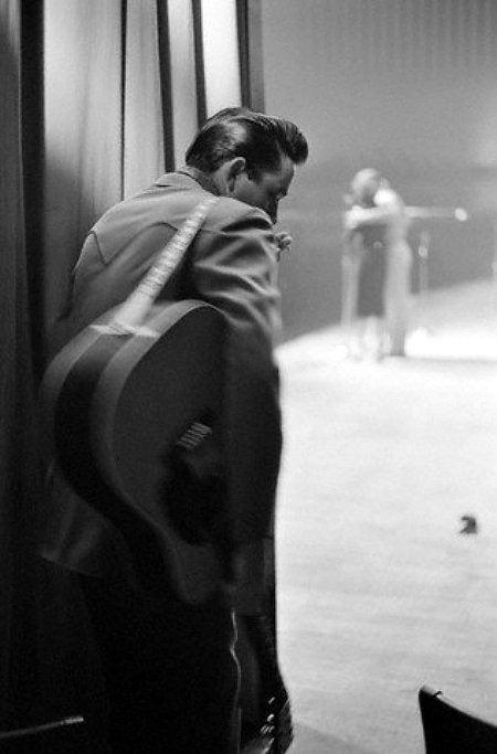 johnny cash prepares to take the stage at a show in white plains, ny, 1959.