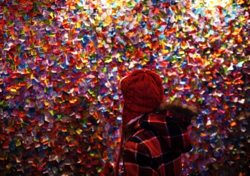 Shen Hong/Xinhua/Zuma24 Confetti covered the New Year's Eve Wishing Wall at the Times Square  Information Center in New York City Friday. All the pieces of paper,  bearing wishes for 2012 from around the world, will rain down on  revellers during the New Year's Eve party in Times Square.