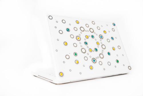 Gear Galaxy StickyBun laptop skin! Starting at $21.50 The Gear Galaxy StickyBun is a 3-Dimensional look that is much more visually exciting than a skin but still maintains a thin, lightweight protective cover that is applied directly to a laptop. This StickyBun is composed of strips of varying size gears and half circle dots arranged visually pleasing pattern. They are inside the see through morphic sheet that maintains a tactile quality when touching the gears and the colored dots. On the back there are thin strips of adhesive along the edges and adhesive dots in the middle. The adhesive stays very well, but can be taken off at any point. The StickyBun can be removed by simply peeling off the StickyBun and rolling off any leftover gel with your fingertips. The Gear Galaxy StickyBun is extremely durable and its lifespan is about a year. It protects laptops from nicks and scratches while looking intriguing and personalizing your laptop. Each StickyBun is unique and handmade in the United States. Because the items are handmade the arrangement will not always as they appear in the photos but the concepts, creativity, and care will remain the same.  Click on the photo to be directed to the Rapt website! Follow us on twitter: @All_Rapt_Up