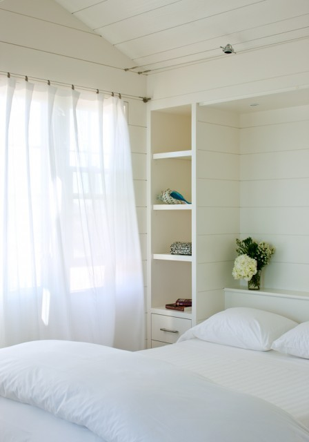 I love this fresh, bright, and breezy bedroom, with the billowing, filmy curtains and a bed nestled into an alcove, framed by built-in shelves and painted wooden walls and ceiling. (via Woodmeister Master Builders)