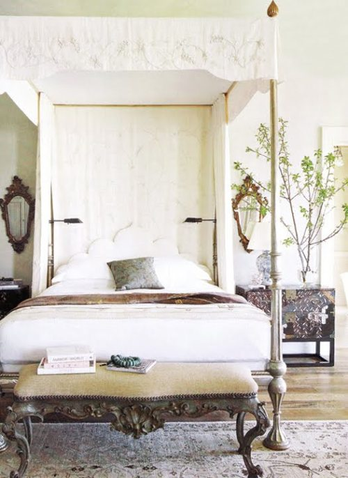 A bright, white bedroom with a canopy bed, and eclectic antique and vintage furniture (via eclectic revisited by Maureen Bower)