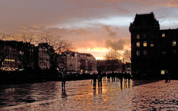 Rita Crane Photography:  Paris / Ile de la Cite / sunset / silhouette / sky / umbrellas / rain / people / architecture  / Rainy Evening at Place du Parvis Notre Dame, Paris by Rita Crane Photography on Flickr.