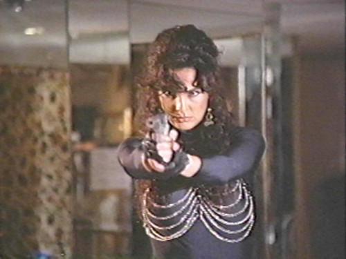 gunsandposes:  Julie Strain inFit to Kill, 1993, directed by Andy Sidaris.