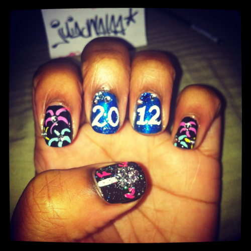 Just some new years 2012 nail art :) I was rushing so it's not my best but i still think its cute.. Happy new year every1!!!  Xoxo- Julia