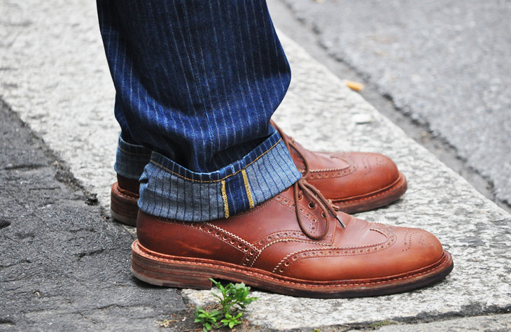 Pinstripe denim and brown leather in Milan