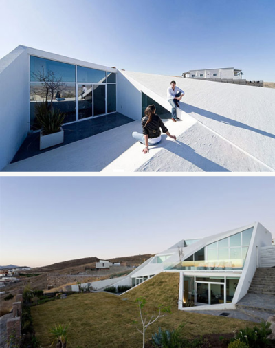 The House in Chihuahua, Mexico by Productora is built into a mountainside in a golf resort community.