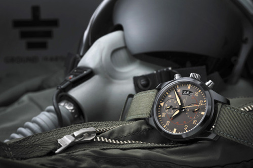 IWC 2012 Top Gun Marimar Chronograph Swiss timepiece manufacturer IWC is gearing to release a new chronograph with the Top Gun Miramar. The watch is one of five new models within the brand's Pilot collection being introduced throughout 2012. Boasting technical upgrades, the piece also highlights a virtually scratch proof case connected to a green textile strap. In staying true to its name, the overall aesthetic welcomes unmistakable military inspiration.
