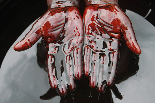 newsflick:  Nigeria: A man covers his hands in crude oil during an anti-Shell protest after a spill at the Bonga oilfield. (EPA via Guardian)  That is a fascinating story told in a single photo. Here's a Reuters story on the topic.
