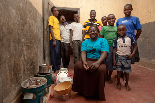 Lucy, mother of 7, earns a living as a vendor for charcoal-efficient stoves in her community. Learn more at www.theadventureproject.org.