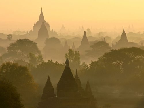 filchingmagpie:  A sunrise skyline in Bagan, Myanmar, photographed by Cynthia Dial via National Geographic. Layers upon layers of trees and temples: a mix of the man-made and the natural, blending harmoniously.