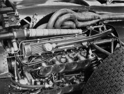 "The mighty BRM H-16 engine, first built in 1966. This strange, complex, engine consists of two 1.5 liter 16 valve 180 degree V8's, placed on top of each other, forming the unique 'H-16' shape. It produced some 405 horsepower at 10500 revs, but it was terribly over-weight, and very unreliable. To top it all off, it was very difficult to drive, due to a lack of torque. Jackie Stewart is believed to have said ""This piece of metal is better used as a ship's anchor, than as a power plant"". The H-16 powered the BRM P83's and the single P115 in 1967."