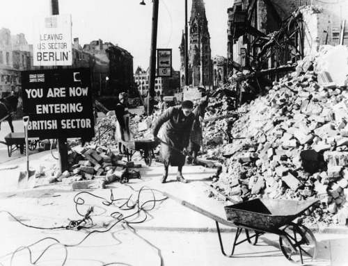 German women cleaning up rubble in Berlin following the end WWII.   Many women were called upon to help in these efforts due to the fact that a large portion of the male population died during the war. Berlin, Germany - 1945.
