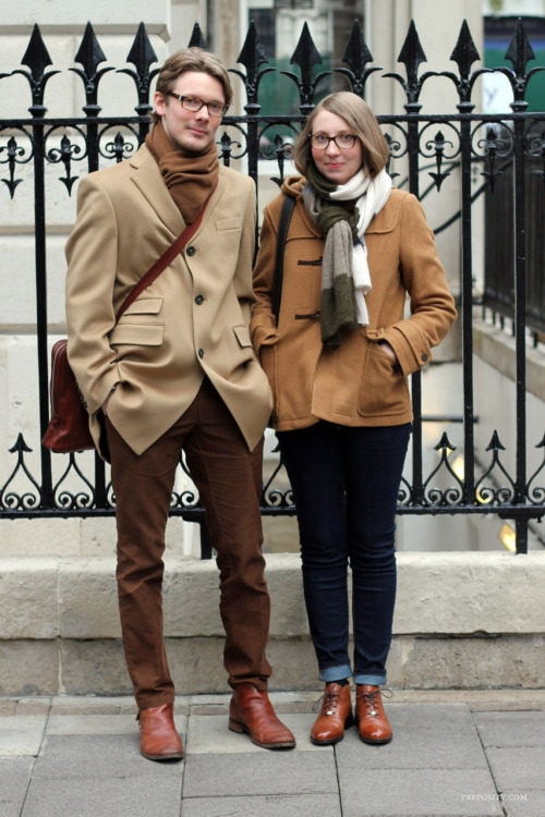 a young couple spotted on the street on Savile Row, LondonJanuary 2012