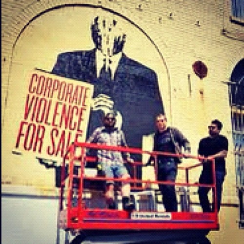 Shepard Fairey puts up his artwork. #obey  (Taken with instagram)