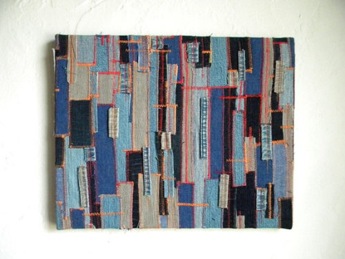 "My Denim Textile Wall Hanging As I previously said, after flipping through the book ""Layered, Tattered and Stitched"" by Ruth Rae, I had great motivation to try my own project.  Well here is was my outcome:A recycled denim textile wall hanging!    (Source.)"