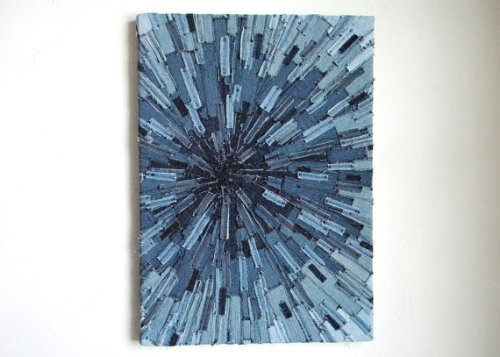 "Denim Sunburst Textile ArtAs I mentioned before, after sifting through the book ""Layered, Tattered and Stitched"" by Ruth Rae I got great inspiration.  First I created a randomized denim textile wall hanging and now I have taken it one step farther and created a denim sunburst wall hanging! The process of making the wall hanging is very simple, yet very time consuming.  I simply cut old denim jeans into small rectangular pieces of all different sizes.  Then I began to sew then one by one onto a fabric backing.  You can easily do a pre-layout design, or you can be like me and let the piece evolve on its own! (Source.)"