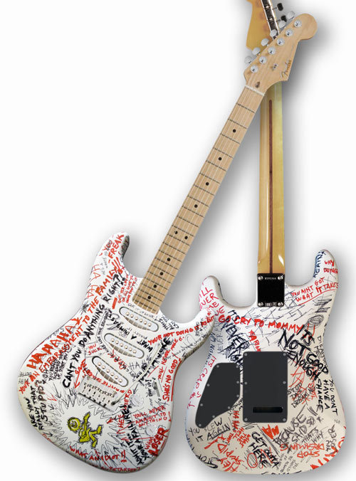 James Hetfield-decorated Strat Hetfield decorated this Strat (which depicts a kid using guitar to ward off negativity) for a 2010 Little Kids Rock charity auction. Musicians like Joe Satriani, Michael Franti, and Slash also decorated guitars.