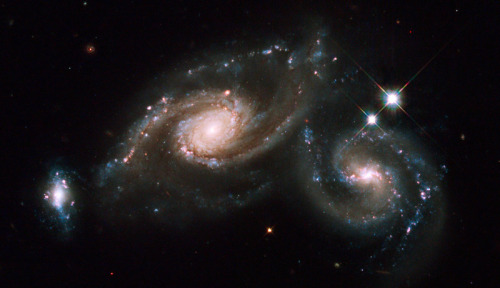 Triple Galaxy Image: NASA, ESA and M. Livio and the Hubble Heritage Team (StSci/AURA)