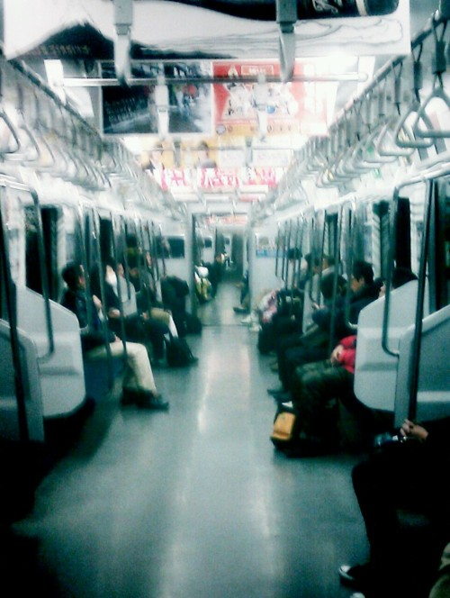 Enjoying a rare view down the carriage while it lasts. The Yamanote Sen at doesn't normally look like this at 6.15pm on a weekday. I even get a seat on which to fall asleep like a proper local.  UPDATE: combined effect of under-seat heating and new puffer jacket resulted in delightful commuter kip, adding four stops to the journey.