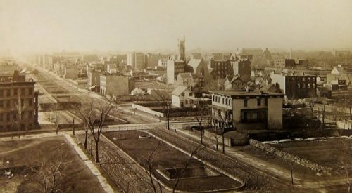 The view south from Park Avenue and 94th Street In Manhattan; 1882.  Michael Kimmelman of The New York Times writes:   In the old photograph, a lonely farmhouse sits on a rocky hill, shaded by tall trees. The scene looks like rural Maine. On the modern street, apartment buildings tower above trucks and cars passing a busy corner where an AMC Loews multiplex faces an overpriced hamburger joint and a Coach store… They are both the same spot.