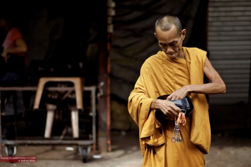 Monk begging for alms | Kuala Lumpur, Malaysia 2010. Canon 5D mkII, EF 85mm f1.8 ABOUT THIS PROJECT Over the past 15 years, I've been lucky to have travelled to a multitude of places and met countless amazing people. This collectively has played a huge role in shaping my world view and making me the person I am today. What I've come to realise is that despite differences in our skin colour, language, socio-economic status, we are all united in our common humanity, that we by and large dream the same dreams and seek the same things in life: Love, security, friendship and a purpose to wake up in the morning. From the archives is a celebration of people, places and travel, and its limitless potential to open eyes and shape minds. From time to time, I will post a photograph I've taken from my archive of 43,000 photos from this period, with a brief description. Some photos are taken on film, some on digital, and I will include any camera equipment details if I have them. Please feel free to comment and let me know your thoughts! View the other photos 'From the Archives'!