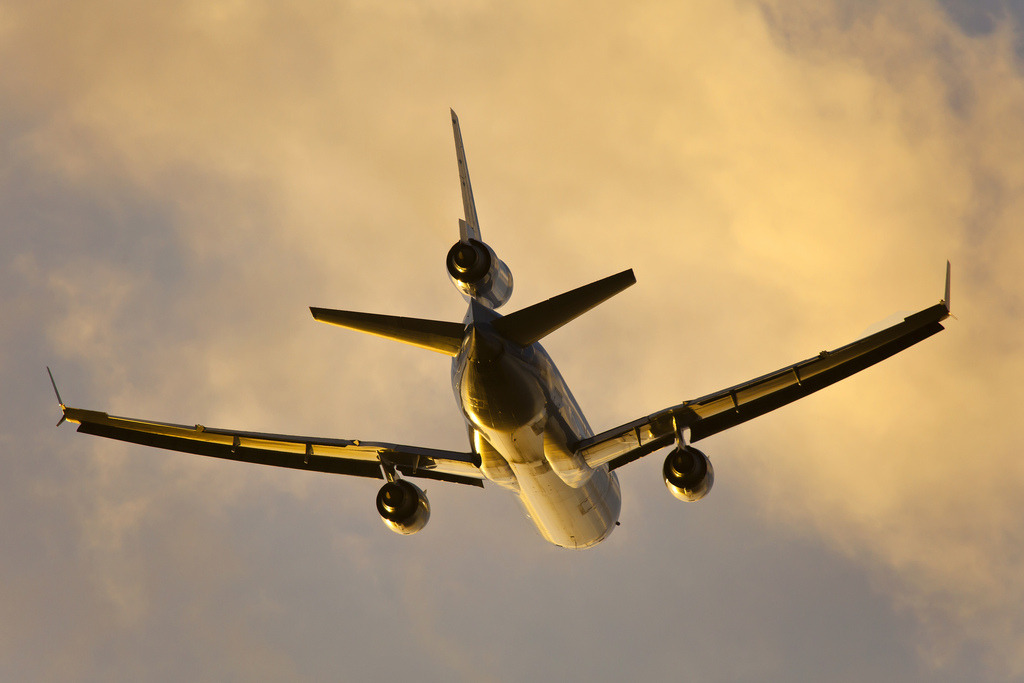 The day's fading light shines on the belly of this MD-11 as it departs Amsterdam Schipol Airport. Photo by Vincent Kuipers. Used with permission. Full version here.