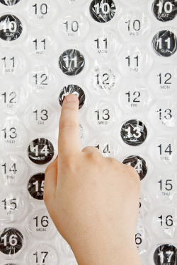 Amazing!   A poster sized bubble wrap calendar that you can pop each day.