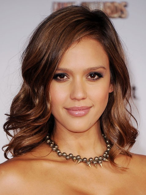 "Jessica Alba's makeup ""The muted cheeks, alluring cat-eyes and monochromatic palette looked especially pretty against Jessica's gorgeous skin tone,"" says makeup artist Fiona Stiles, who used Revlon makeup and EcoTools brushes to create a sophisticated face for Alba.  DO IT YOURSELF! Skin: Use Bamboo Foundation Brush to apply PhotoReady Foundation in Caramel. Set the base with PhotoReady Powder in Medium/Deep, then use fluffy Bamboo Finishing Kabuki Brush to apply ColorStay Mineral Blush in Honey to cheeks. Eyes: Cover lids with the pearlized gray shade of ColorStay Eyeshadow Quad in Sterling Rose, and add a bit of the same gray under the lower lashes. Apply Luxurious Color Eyeliner in Black Velvet at the outer corners, working the color into the lash line with Smudge Brush. Finish with a few coats of Grow Luscious Mascara in Black. Lips: Smooth on ColorBurst Lipgloss in pale Crystal Lilac.    Here is a great look to create that wont drain your bank account.1.  Eco Tools Bamboo Brush Set - $13 2.  PhotoReady Foundation - $10  3.  PhotoReady Powder - $104.  ColorStay Mineral Blush - $85.  ColorStay Eye Shadow Quad - $56.  Luxurious Color Eye Liner - $57.  Grow Luscious Mascara - $88.  Colorburst Lip Gloss - $7"