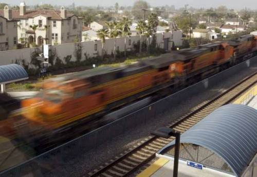 California high-speed rail funding could be in jeopardy:  The Legislature should not authorize the issuance of $6 billion in bonds to start building California's $98.5-billion bullet train project, a state-appointed review panel says in a key report to be released later Tuesday. … Voters authorized $9 billion in bonds for the bullet train project in 2008, but the measure required that the Peer Review Group sign off on the feasibility and reasonableness of the plan to build the rail system before the state issues the bonds. A recent poll indicates a sharp drop in public support for the project.  Photo: A freight train rolls past the Buena Park Metrolink station. Officials say upgrades could allow bullet trains to share rails already in use. Credit: Mark Boster / Los Angeles Times