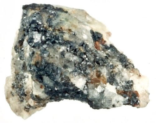 Within this chunk of mineral unearthed in Russia's Koryak mountains are crystalline structures that likely originated in space and were delivered to Earth via meteorite, a new study claims. (via Nobel-Winning Quasicrystals Appear to Have Come From Space | Popular Science)