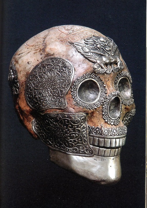 magicanddreamsandgoodmadness:  Tibetan ritual skull with silver work and garuda on the forehead. A garuda is a large mythical bird or bird-like creature that appears in both Hindu and Buddhist mythology.