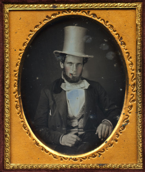 tuesday-johnson:  ca. 1848, [daguerreotype portrait of a gentleman with a top hat and cigar] via I Photo Central  One of the best white tophats I have EVER seen!
