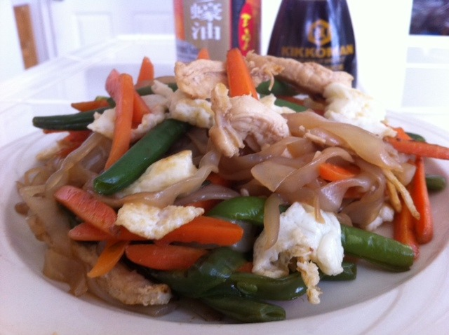 "HEALTHY CHICKEN CHOW MEIN RECIPE Wow, it's been a long time since I've posted on my favvveeee noodles ever. Miracle Noodles! I was inspired to make some healthy Chinese food for lunch today, so this recipe is fresh & piping hot from my wok. Enjoy! INGREDIENTS (for 1 heaping serving): 1 pack of Fettucine or Angel Hair Zero Calorie Miracle Noodles 1 egg or 3 egg whites – I use liquid egg whites, so stop getting on me for wasting yolk!! :P About 7-8 baby carrots, sliced longways A small handful of green beans 1 chicken breast, boiled, then chopped 1 TBS oyster sauce 1 tsp of soy sauce pinch of salt & pinch of pepper little bit of sesame oil or olive oil to stir-fry  Make sure to rinse your noodles thoroughly. Then pat them dry between 2 paper towels.  You can get Oyster Sauce at your local Asian food mart. But I know they sell it in the international section of Wal-Mart and major grocery stores now! It's about $2-$3.  Make sure your pan is hot with the thin coating of oil before you toss the goodies in! This way you'll hear the simmering sounds. My fave. And you get some nice color to the chicken. I add in my sauce after I throw everything in. (Oh yeah, but make your eggs separately first.) You can add salt and pepper til you get the desired taste. But that's it! And yes, the noodles are really calorie free. They taste kind of chewy and take on the flavor of whatever you throw on them. So my noodles embraced the oyster and soy sauces. It was so good. Enjoy and yes there is such a thing as healthy Chinese food! I'll probably be doing more Asian inspired dishes with Lunar New Year coming up around the corner! I just got an email saying that if you use code ""2012″ you'll get 12% off your order. Umm, buy now!!?? Go here. Expires Sunday Jan 8th. NUTRITION FACTS (with egg whites):   Over 60g of protein! And under 350 cals! NICE!!!!!"