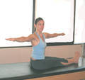 Daily Pilates Pose 22: Spine Twist 1. Sit up very tall with your arms stretched to either side of the room. 2. Straighten your legs out in front of you with your feet flexed. 3. Twist your torso to the right, squeezing your buttocks and legs together tightly. 4. Return to the starting position. Repeat the movement to the left. 5. Complete 3 sets. Do not allow your hips or heels to shift as you twist your torso. Use your breath to increase the stretch.