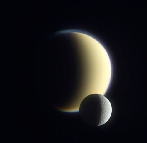 ikenbot:  Hazy Titan Featuring the smaller, cloudless Dione seen on December 10, 2011 by the Cassini spacecraft. (NASA/JPL/SSI/J. Major)