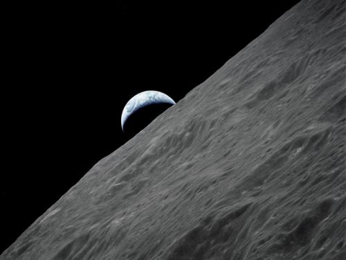 firsttimeuser:  Crescent Earth The crescent Earth rises above the lunar horizon in this spectacular photograph taken from the Apollo 17 spacecraft in lunar orbit during final lunar landing mission in the Apollo program.