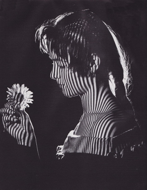Girl with flower, c1965 by Karel van Straaten