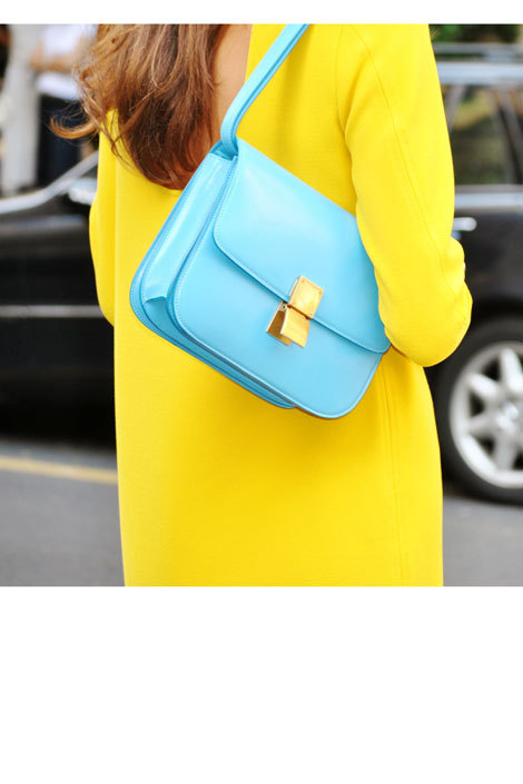 A robin's egg blue Céline bag meets its math in a canary yellow frock.