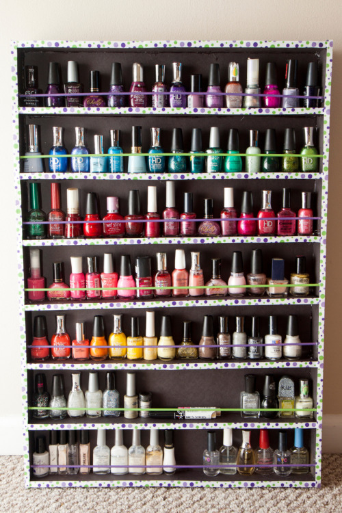 The nail polish rack that I made this week. It holds about 105 bottles of nail polish and it cost about $6 or $7 to make. It would be cheaper if you didn't use the ribbons and wooden rods, but hey, that's still a LOT better than the $45 acrylic one they sell on Amazon. :)