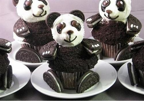 Some frikkin' awesome oreo panda cupcakes! We're trying very hard (though not hard enough) to cut back from all the holiday sweets, but it'd be hard to resist these!