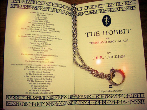 "fuckyeahbibliophilia:  Happy 120th birthday J.R.R Tolkien! wherever you may roam… Thanks you for all the stories, all the hobbitses, the elves, the men, the orcs,  the wizards, the forests the magic! To accompany this salutation, a picture I took from my copy of ""The Hobbit"" with my mother's ""The one ring""… we're quite a family, yeah! Looking forward to the movie and to seeing Martin Freeman as a hobbit! =O See ya around! xoxo Maru"