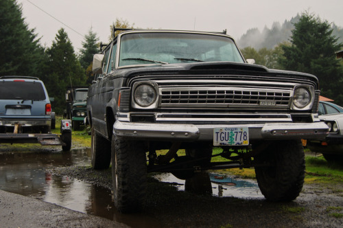 1970-73 AMC Jeep Wagoneer, the last one before being replaced by the Cherokee nameplate.  This truck has a tasteful lift, and one of the coolest front ends in Jeep history, though the Cherokee did manage to improve on the sidemarkers, which look a lot more '60s then they ought to.  Seen outside of Banks, OR