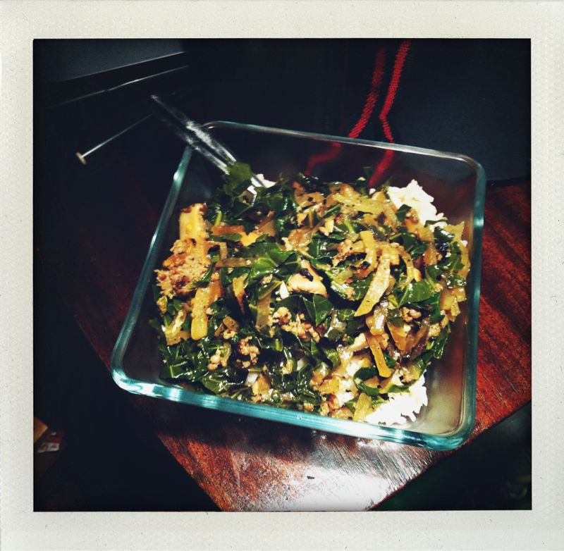 Sauteed chiffonade collard greens, julienned daikon, and sausage on rice